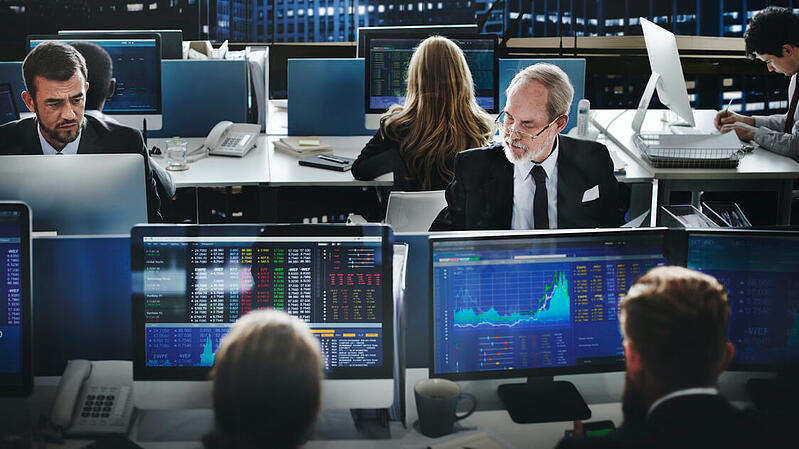 People using technology in financial risk management