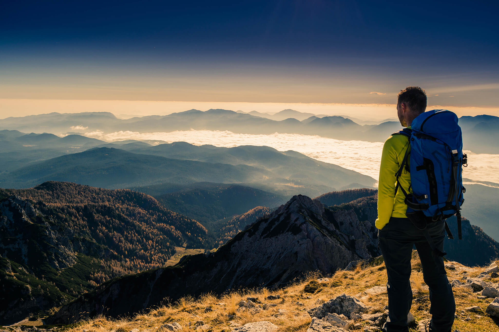 Protecht-mountain-climber-looking-out-horizon